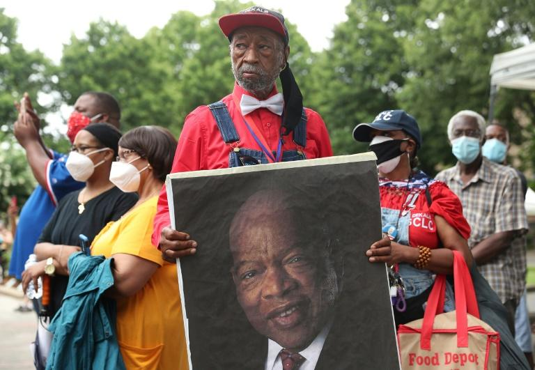 Mourners outside the Ebenezer Baptist Church during the funeral service for John Lewis (AFP Photo/JOE RAEDLE)