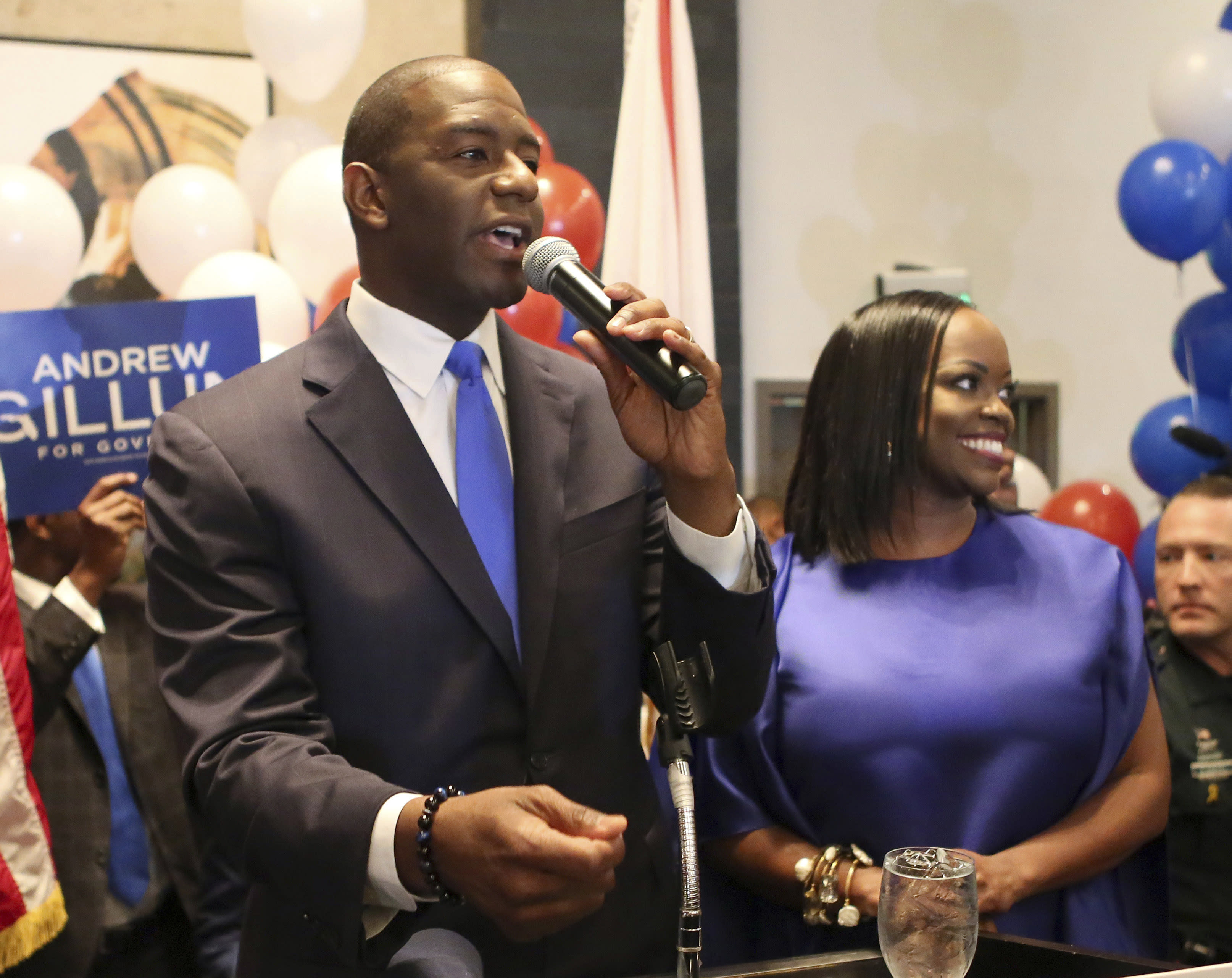 FILE - In this Tuesday, Aug. 28, 2018 file photo, Andrew Gillum and his wife, R. Jai Gillum addresses his supporters after Andrew Gillum won the Democratic primary for governor in Tallahassee, Fla. The history-making gubernatorial runs by Stacey Abrams of Georgia, Gillum of Florida and Ben Jealous of Maryland are turning them into stars nationwide and at the Congressional Black Caucus annual legislative conference. If elected, Abrams, Jealous and Gillum, would give America its largest number of black governors ever. (AP Photo/Steve Cannon, File)