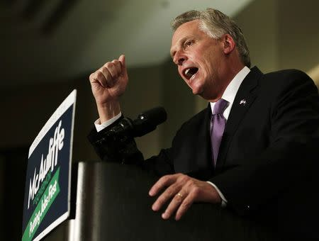 Virginia Democratic governor-elect Terry McAuliffe speaks to supporters during his election night victory rally in Tyson's Corner, Virginia November 5, 2013. REUTERS/Gary Cameron/Files