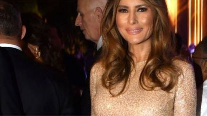Melania turns heads in skintight gold gown