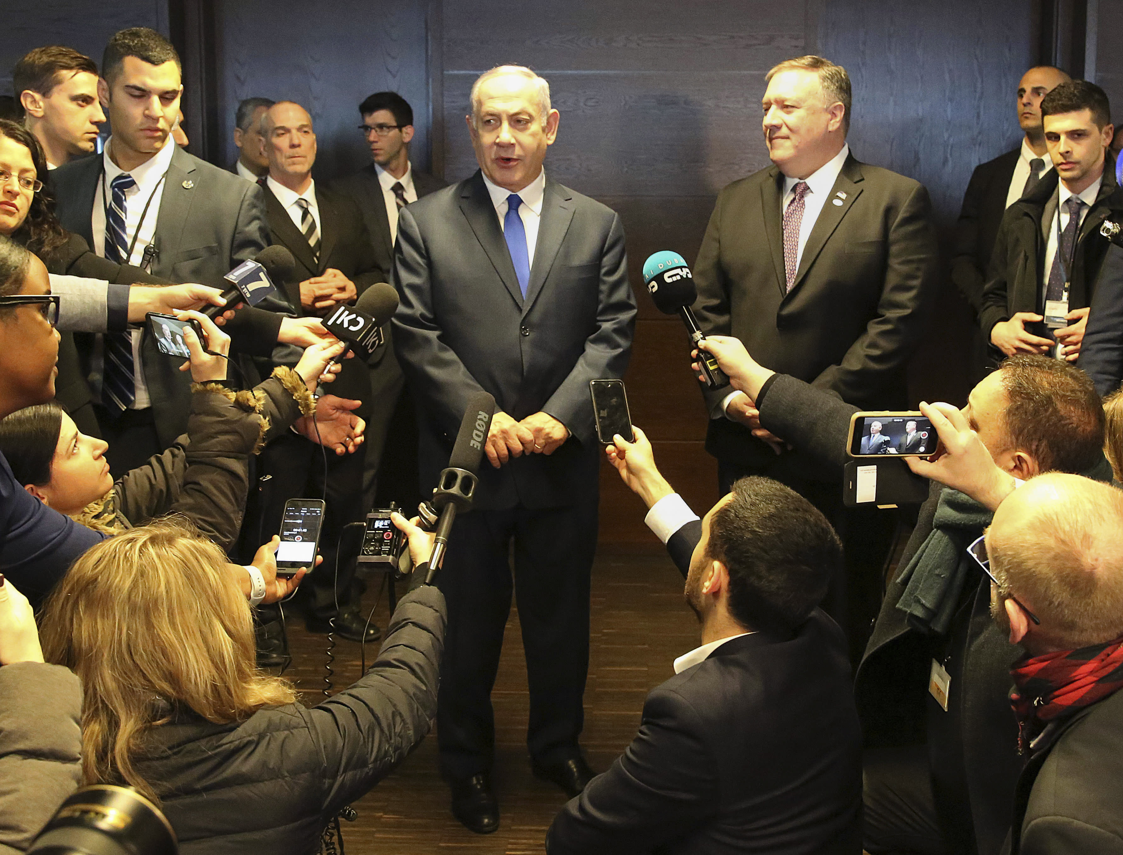 FILE - In this Thursday, Feb. 14, 2019 file photo, Israeli Prime Minister Benjamin Netanyahu, center left, and US Secretary of State Mike Pompeo, center right, address journalists on the sidelines of an international conference on the Middle East in Warsaw, Poland. An off-hand comment by Netanyahu in Warsaw about Poland and the Holocaust looks to overshadow a summit of central European leaders this week in Israel. Poland's abrupt decision Sunday to downgrade its participation in the Visegrad conference suddenly cast a pall gathering. (AP Photo/Czarek Sokolowski, File)
