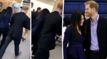 Prince Harry and Meghan Markle catch train hand-in-hand