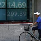 Asian shares rise after Wall St rally, strong housing data