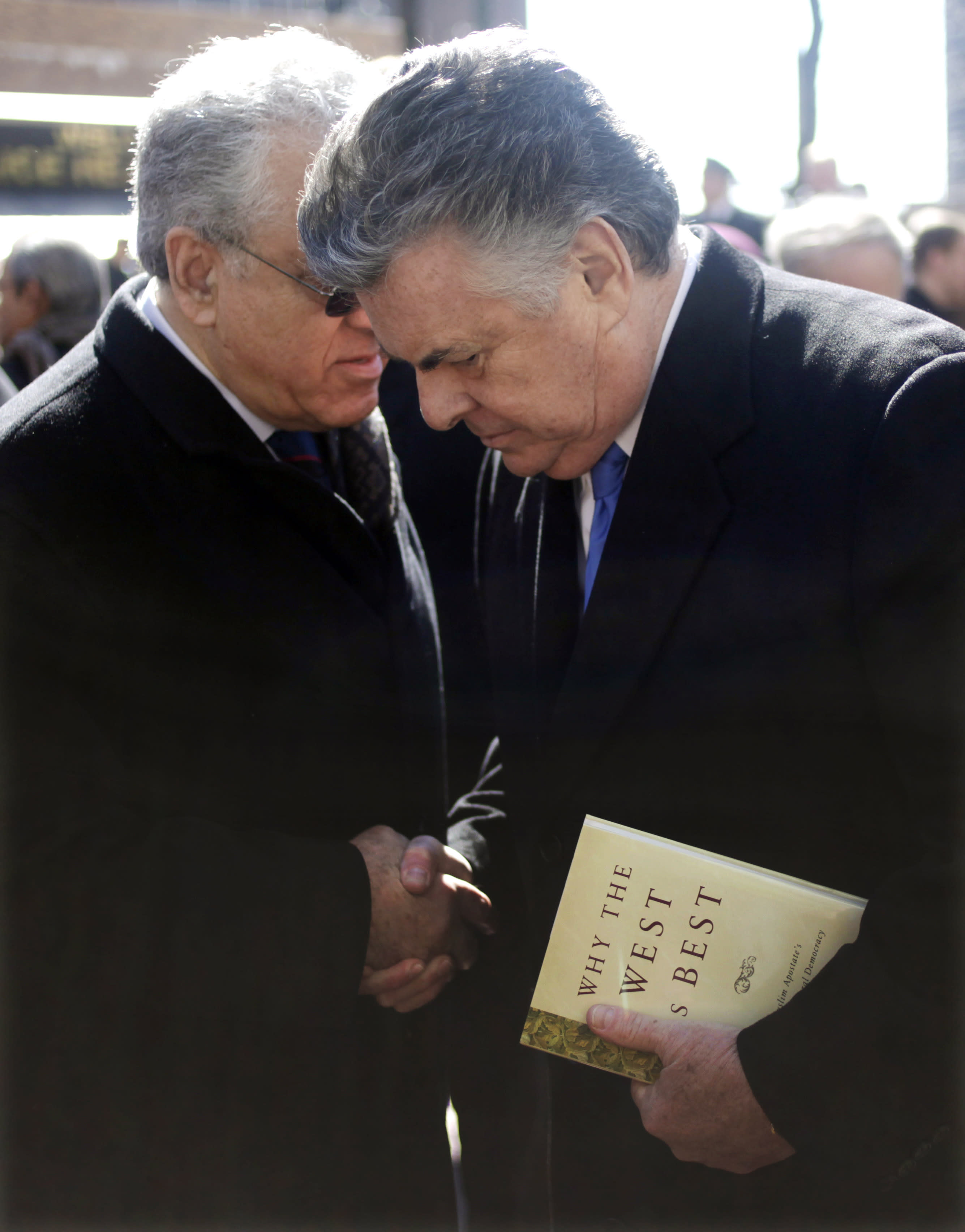 U.S. Rep. Peter King, R-N.Y., right, chairman of the House Committee on Homeland Security, meets with supporters at a news conference in front of police headquarters in New York, Monday, March 5, 2012. King was present with dozens of activists to demonstrate support for the NYPD and their surveillance of Muslim communities. (AP Photo/Seth Wenig)