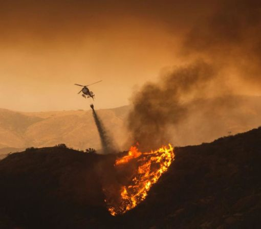Wildfire Rages Through Southern California, Gutting 18 Homes