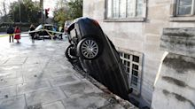 Man arrested after Mercedes found wedged nose-down in a BASEMENT