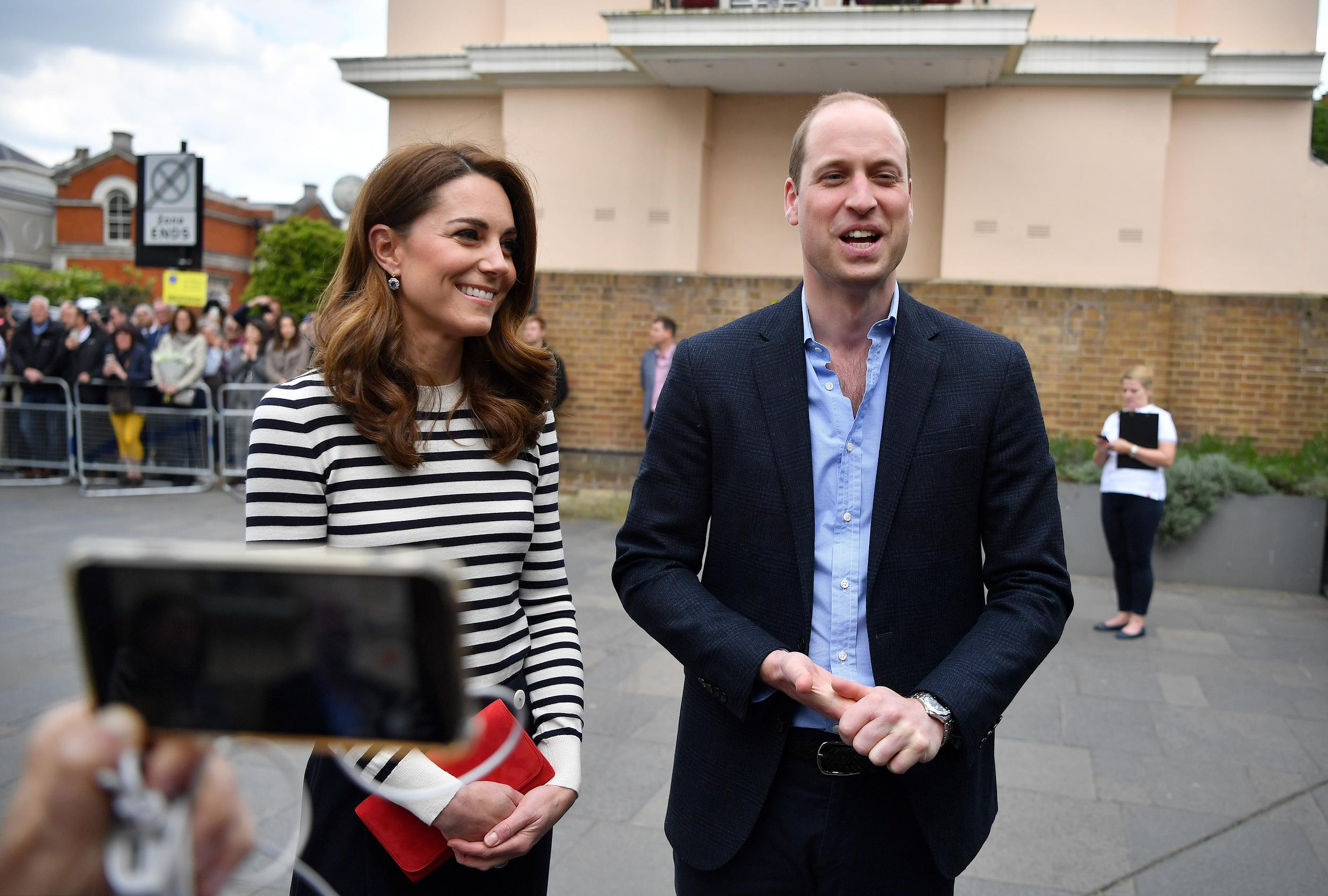 The Duke and Duchess of Cambridge talk to members of the media about their newborn nephew as they arrive to launch the King's Cup Regatta trophy at the Cutty Sark, London.