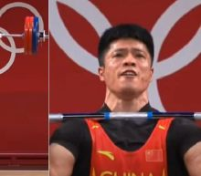 China's weightlifter showcases one-legged 'flamingo' lift before winning Olympic gold