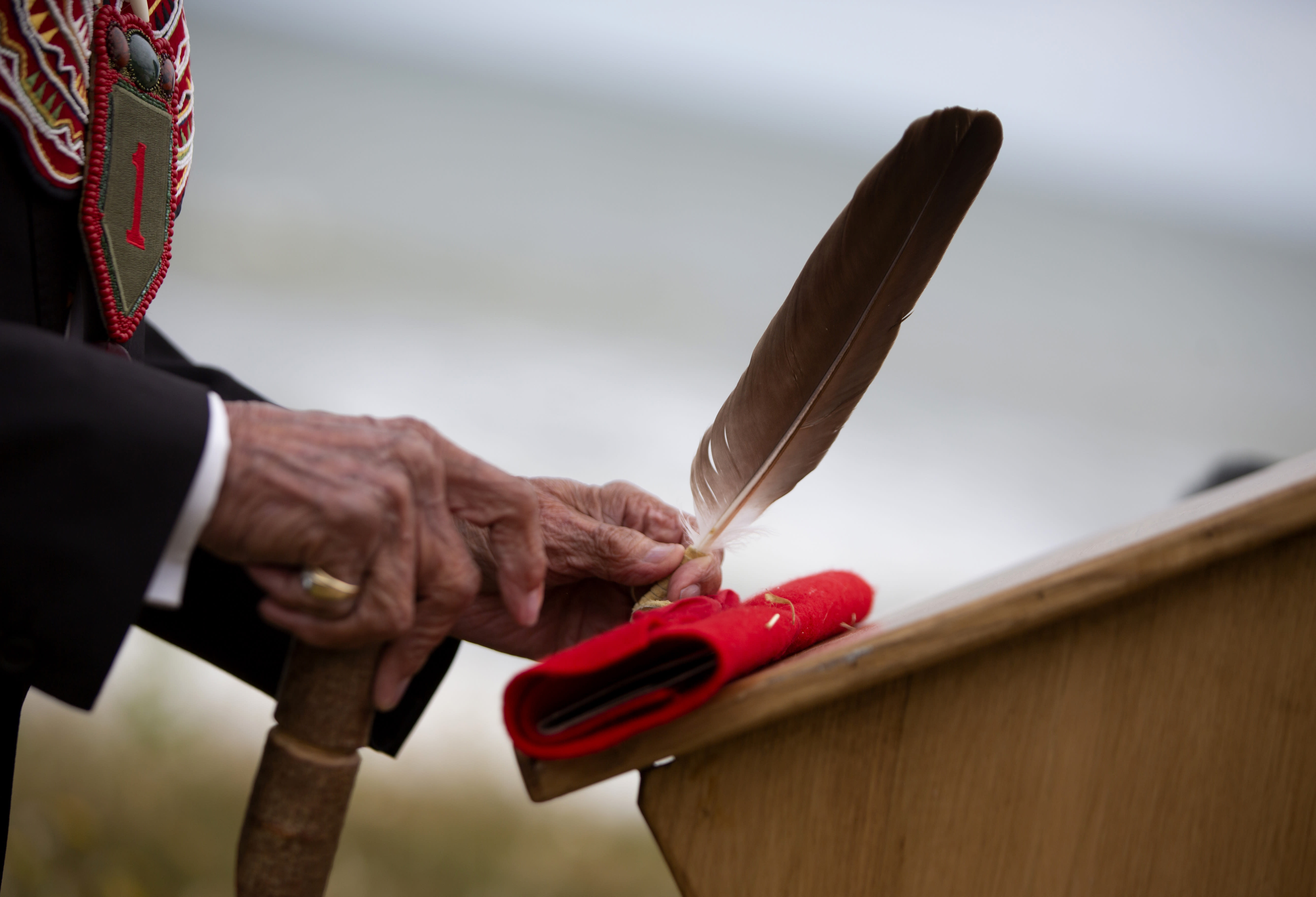World War II D-Day veteran and Penobscot Elder from Maine, Charles Norman Shay participates in a Native American ceremony at his memorial overlooking Omaha Beach in Saint-Laurent-sur-Mer, Normandy, France, Friday, June 5, 2020. Saturday's anniversary of D-Day will be one of the loneliest remembrances ever, as the coronavirus pandemic is keeping almost everyone away, from government leaders to frail veterans who might not get another chance for a final farewell to their unlucky comrades. (AP Photo/Virginia Mayo)