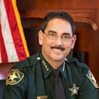Florida Sheriff Bans Deputies, Visitors from Wearing Masks amid State's Record COVID-19 Deaths