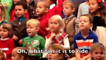 Kindergartner Signs at School Concert for Deaf Parents