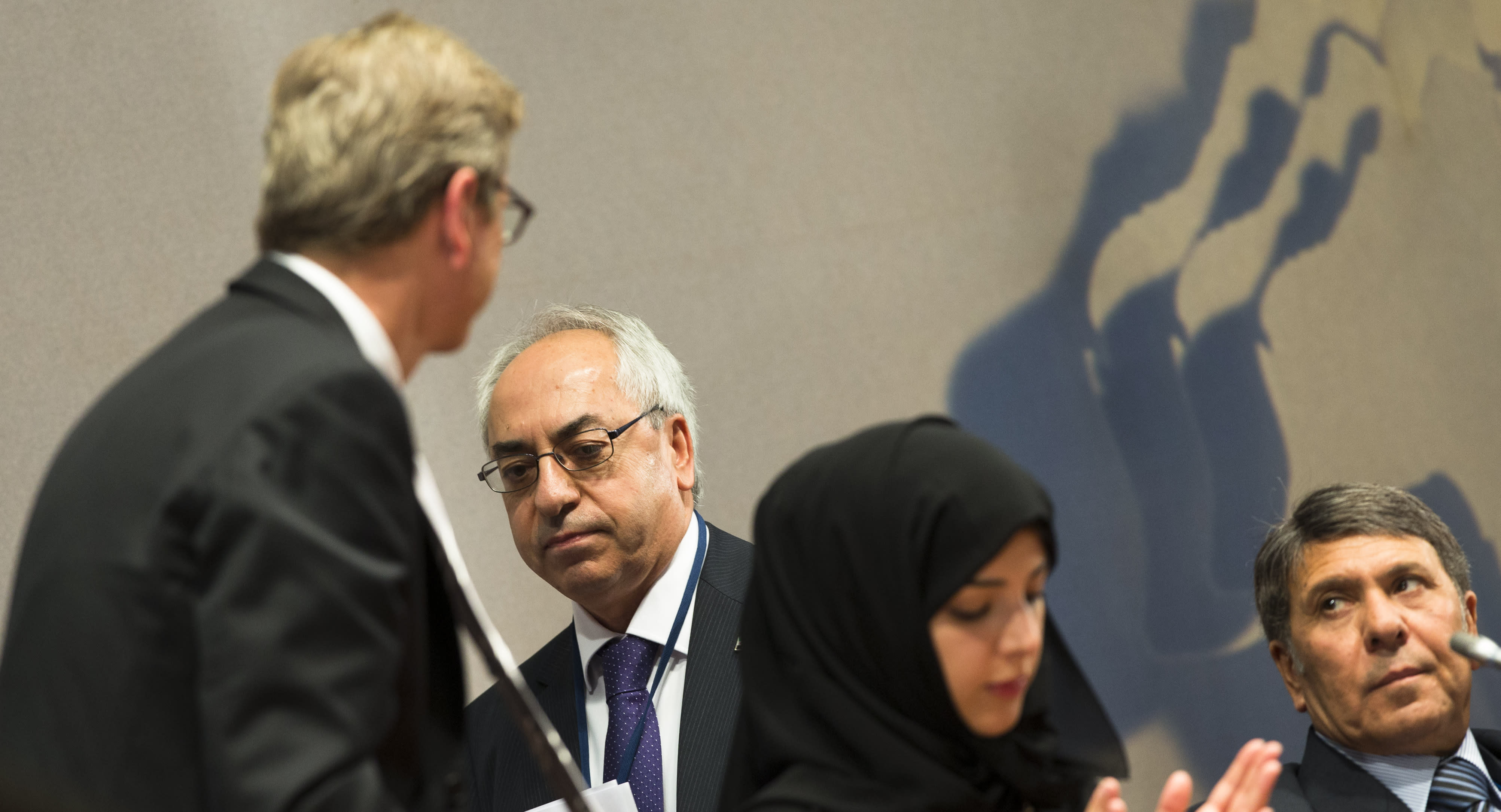 The President of the Syrian National Council Abdulbaset Sieda, second left, receives applause from German Foreign Minister Guido Westerwelle, left, Minister of State of the United Arab Emirates Reem al-Hashimi, second right, and from former Syrian Vice Oil Minister Abdo Hussameddin, right, after his speech to a gathering of Syrian opposition representatives and diplomats hosted at the Germany foreign ministry in Berlin, Tuesday, Sept. 4, 2012. Germany's foreign minister is pressing disparate Syrian opposition groups to unite in preparation for the collapse of the Bashar Assad regime. Berlin hosted a gathering of Syrian opposition representatives and diplomats Tuesday to address how to prevent basic services and infrastructure collapsing, and how to revive the economy, once Assad falls. (AP Photo/Markus Schreiber)