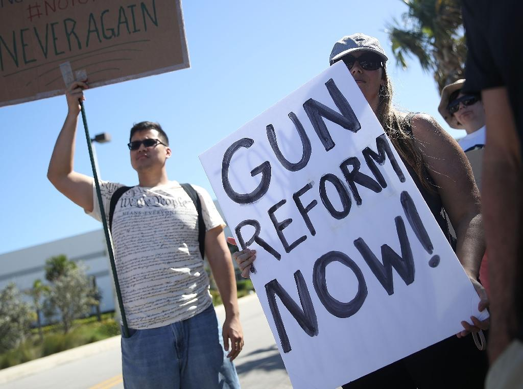 Activists protest outside Kalashnikov USA, a manufacturer of AK-47 rifles, on February 25, 2018 in Pompano Beach, Florida, near Parkland where the shooting deaths of 17 students and staff at a school has boosted calls for gun control (AFP Photo/JOE RAEDLE)