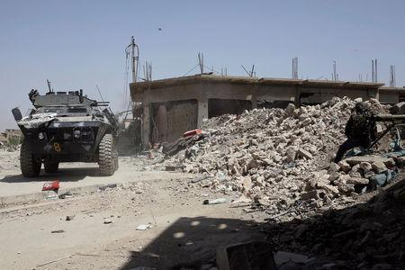 An armoured vehicle of the Iraqi Federal Police fires against positions of Islamic State fighters in western Mosul, Iraq May 29, 2017. REUTERS/Alkis Konstantinidis