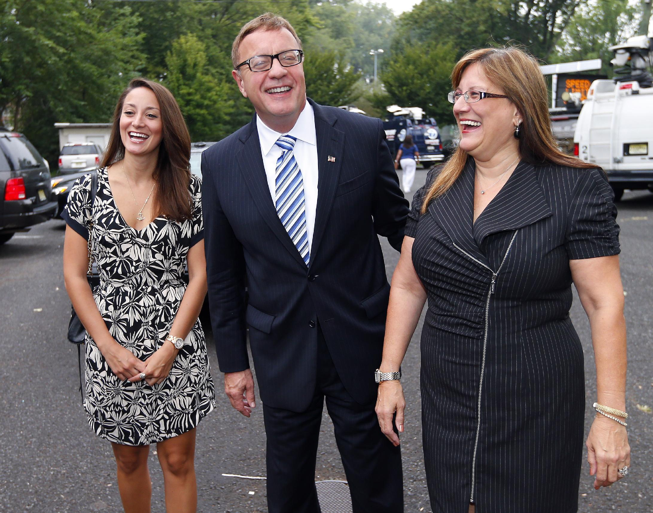 Republican U.S. Senate candidate Steve Lonegan arrives at the Bogota Recreation Center to vote with his daughter Brooke, left, and wife, Lorraine, in the special election primary in Bogota, N.J., Tuesday, Aug. 13, 2013. (AP Photo/Rich Schultz)