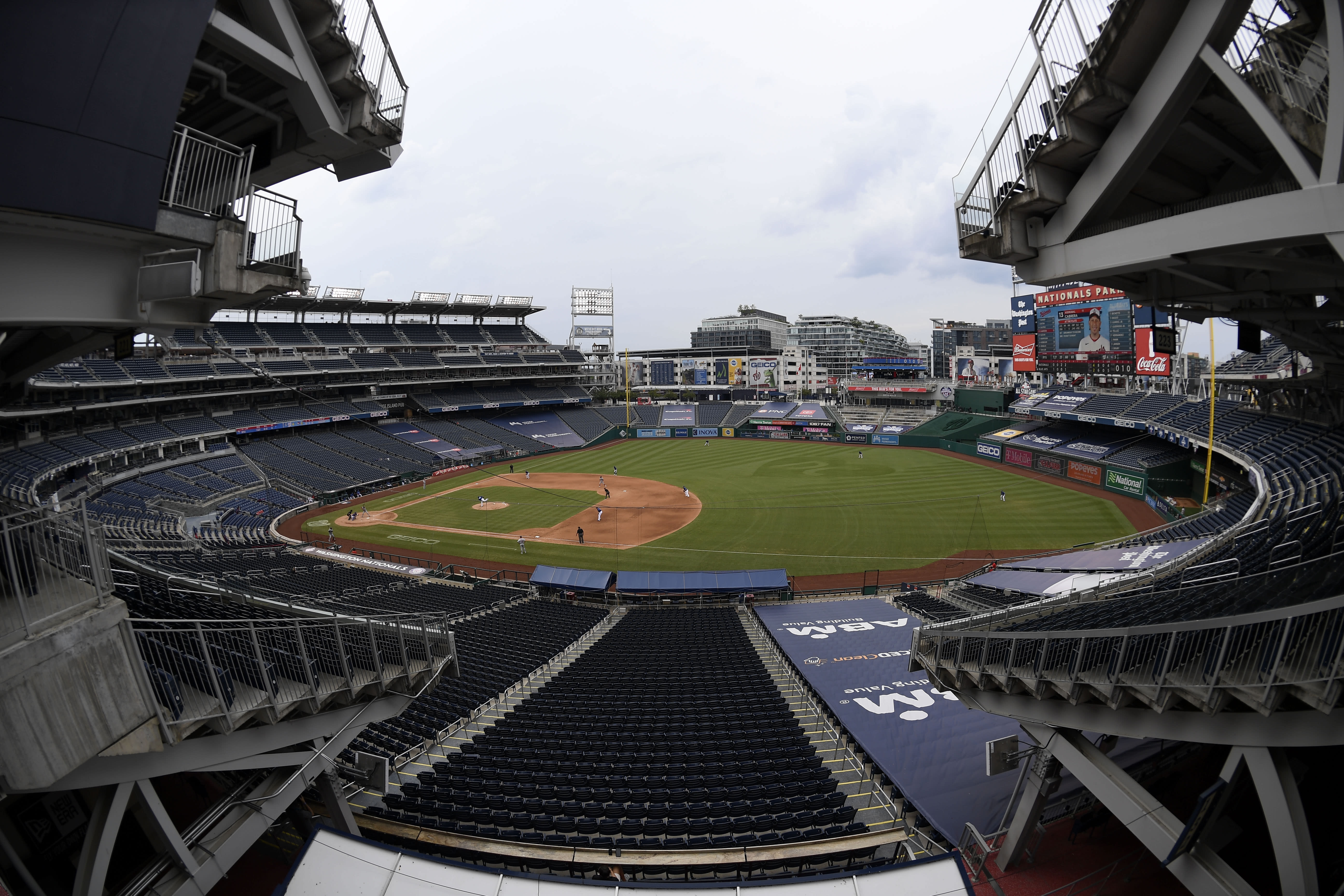 In this photo taken with a fisheye lens, the Toronto Blue Jays and the Washington Nationals compete during the fifth inning of a baseball game Thursday, July 30, 2020, in Washington. (AP Photo/Nick Wass)