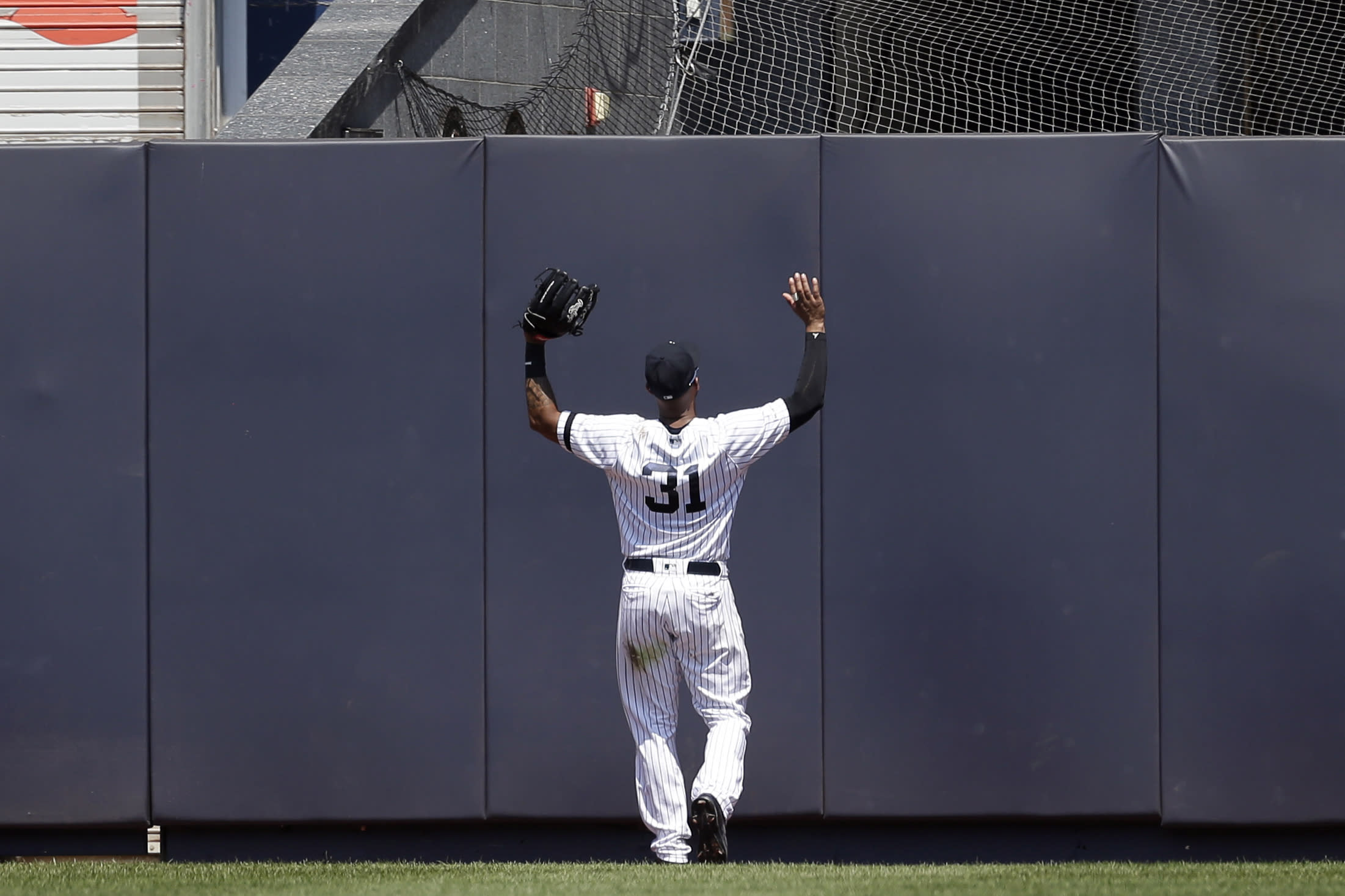 New York Yankees center fielder Aaron Hicks reacts as Colorado Rockies' Trevor Story hits a two-run double during the fourth inning of a baseball game at Yankee Stadium, Sunday, July 21, 2019, in New York. (AP Photo/Seth Wenig)