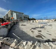 Fire rescue crews leave site of Surfside condo collapse after month-long response