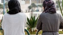 Two Malaysians caned in public for 'attempting lesbian sex'