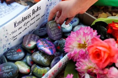 FILE PHOTO - Pebbles with messages are seen at a memorial site for victims of Friday's shooting, in front of Christchurch Botanic Gardens in Christchurch