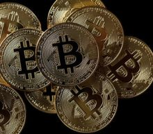 Hotly anticipated bitcoin futures surge 21 percent on debut