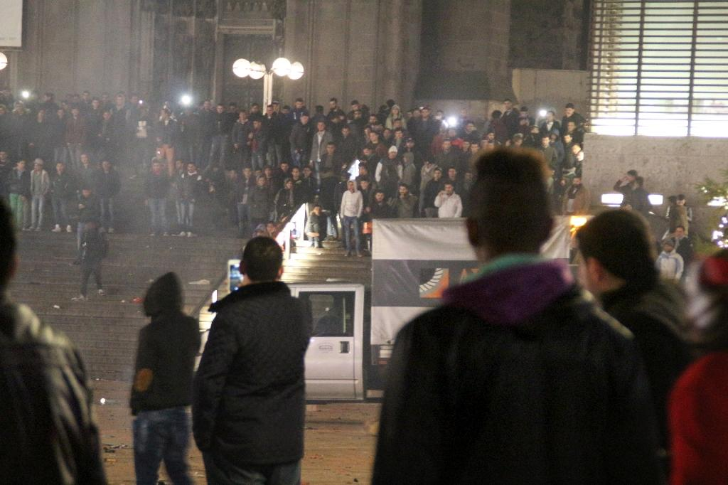 People gather in front of the main railway station in Cologne, western Germany on New Year's Eve (AFP Photo/Markus Boehm)