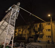 Polish activists pull down statue of priest in abuse protest