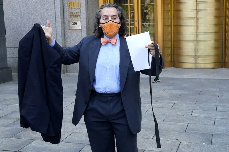 Attorney for Michael Cohen, Jeffrey Levine holds Cohen's belt and jacket up as he tells the media Cohen has been remanded outside Federal Court in the Manhattan Borough of New York City