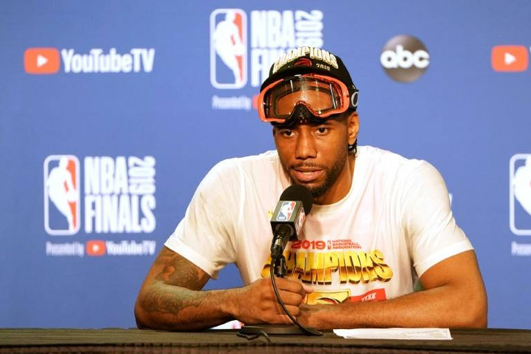 7e802de3 NBA star free agent Kawhi Leonard is expected to meet this week with the  Los Angeles