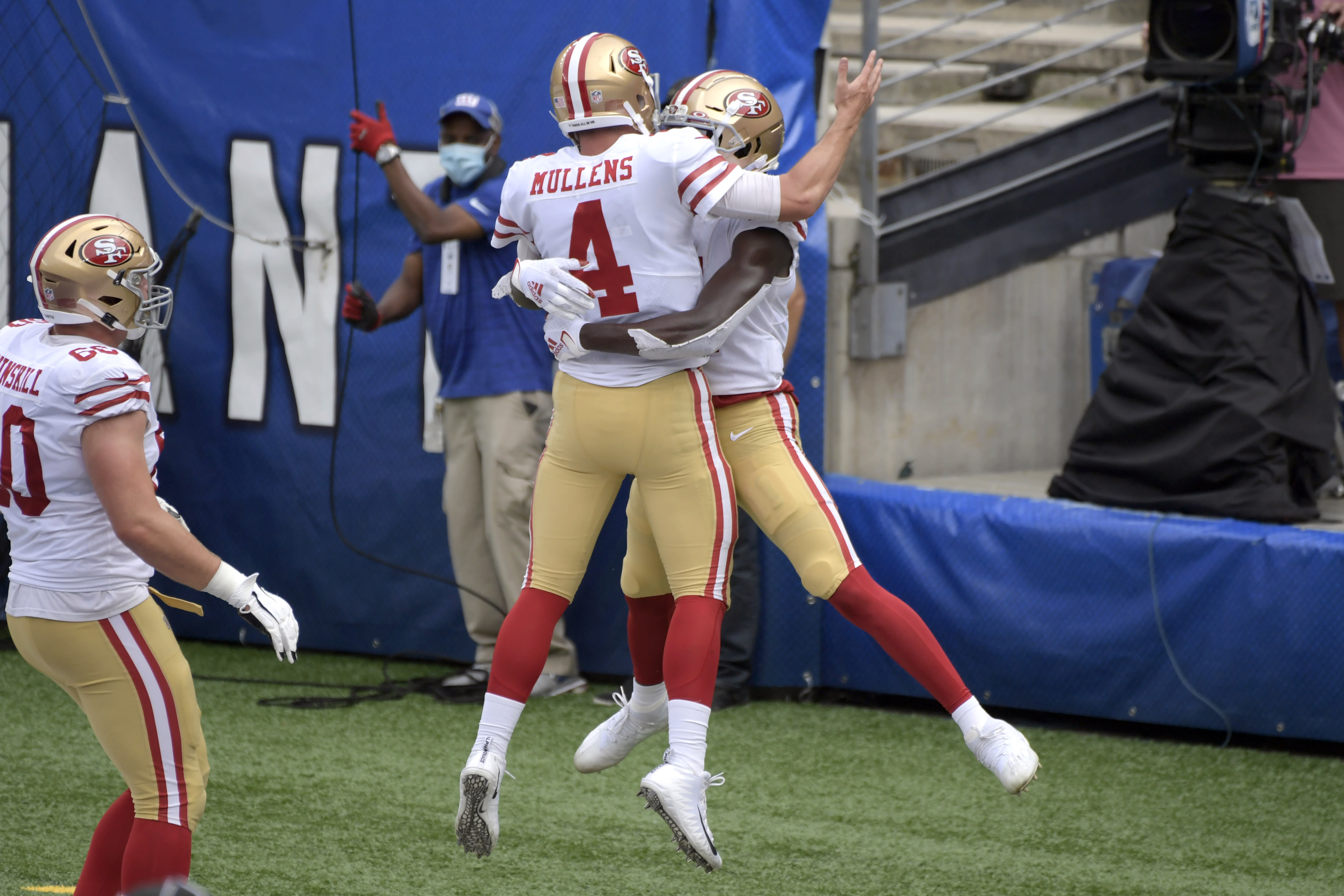 San Francisco 49ers quarterback Nick Mullens (4) celebrates with Brandon Aiyuk during the second half of an NFL football game against the New York Giants, Sunday, Sept. 27, 2020, in East Rutherford, N.J. (AP Photo/Bill Kostroun)