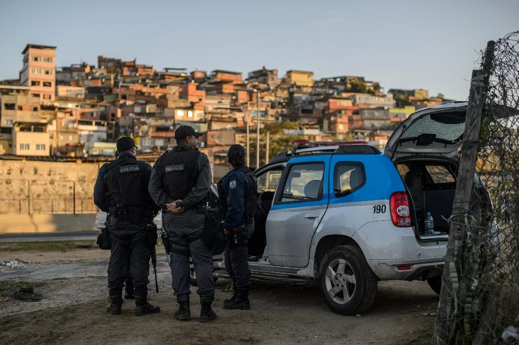 Police and soldiers have been deployed to keep the peace during Rio 2016 (AFP Photo/CHRISTOPHE SIMON)