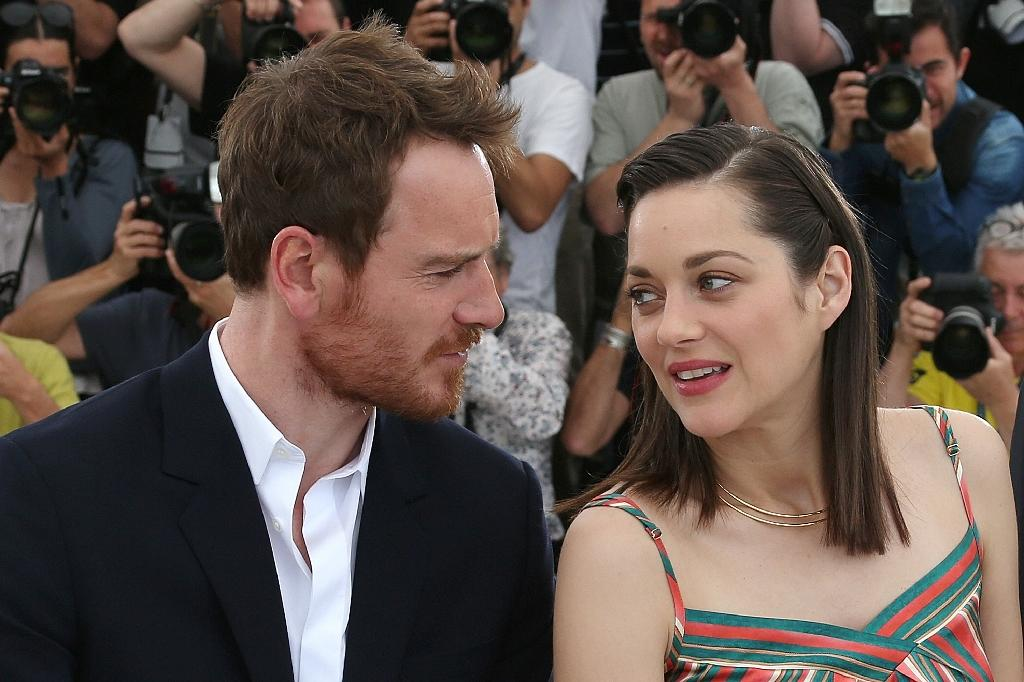 "German-Irish actor Michael Fassbender (L) and French actress Marion Cotillard star in ""Macbeth"", screened at Cannes Film Festival on May 23, 2015 (AFP Photo/Vaalery Hache)"