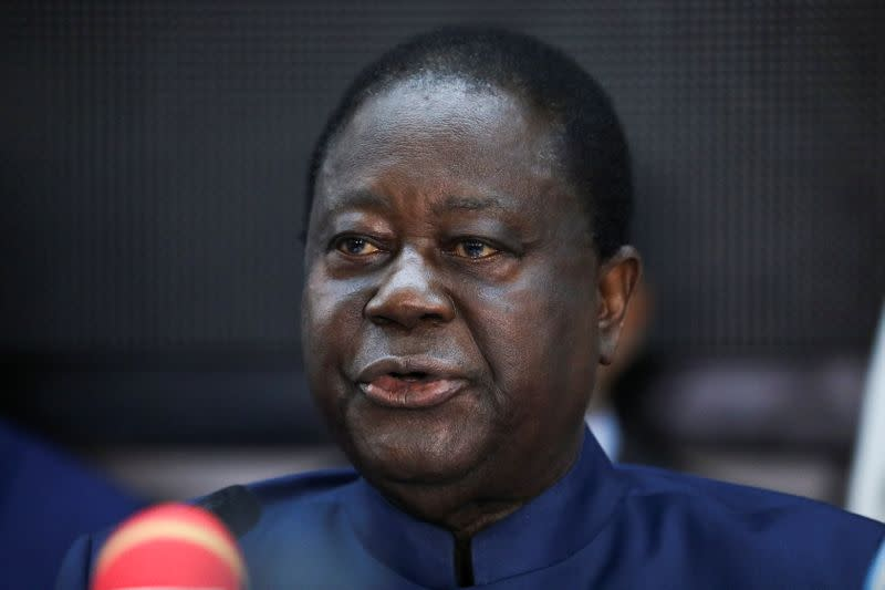 Former Ivory Coast President Henri Konan Bedie, candidate of the Democratic Party of Ivory Coast (PDCI) for the October 31 presidential election, speaks during an opposition meeting in Abidjan