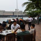Elated passengers leave Cambodia cruise ship after virus all-clear