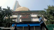 Sensex, Nifty inch lower; all eyes on Reliance ahead of results
