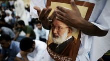 Bahrain police fire on Shiite protest, one reported dead