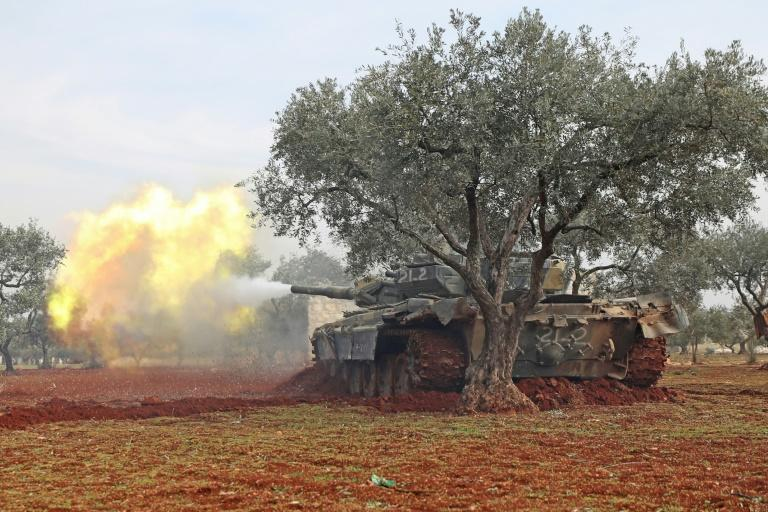 Syrian rebel fighters fire at government forces from positions in Idlib province (AFP Photo/Omar HAJ KADOUR)