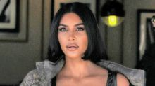 Kim Kardashian Gets Risky in Skims Bralette & Boxer Shorts With Ribbon-Wrap Sandals