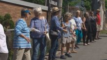 Hundreds gather to move books, one by one, into new Lunenburg library