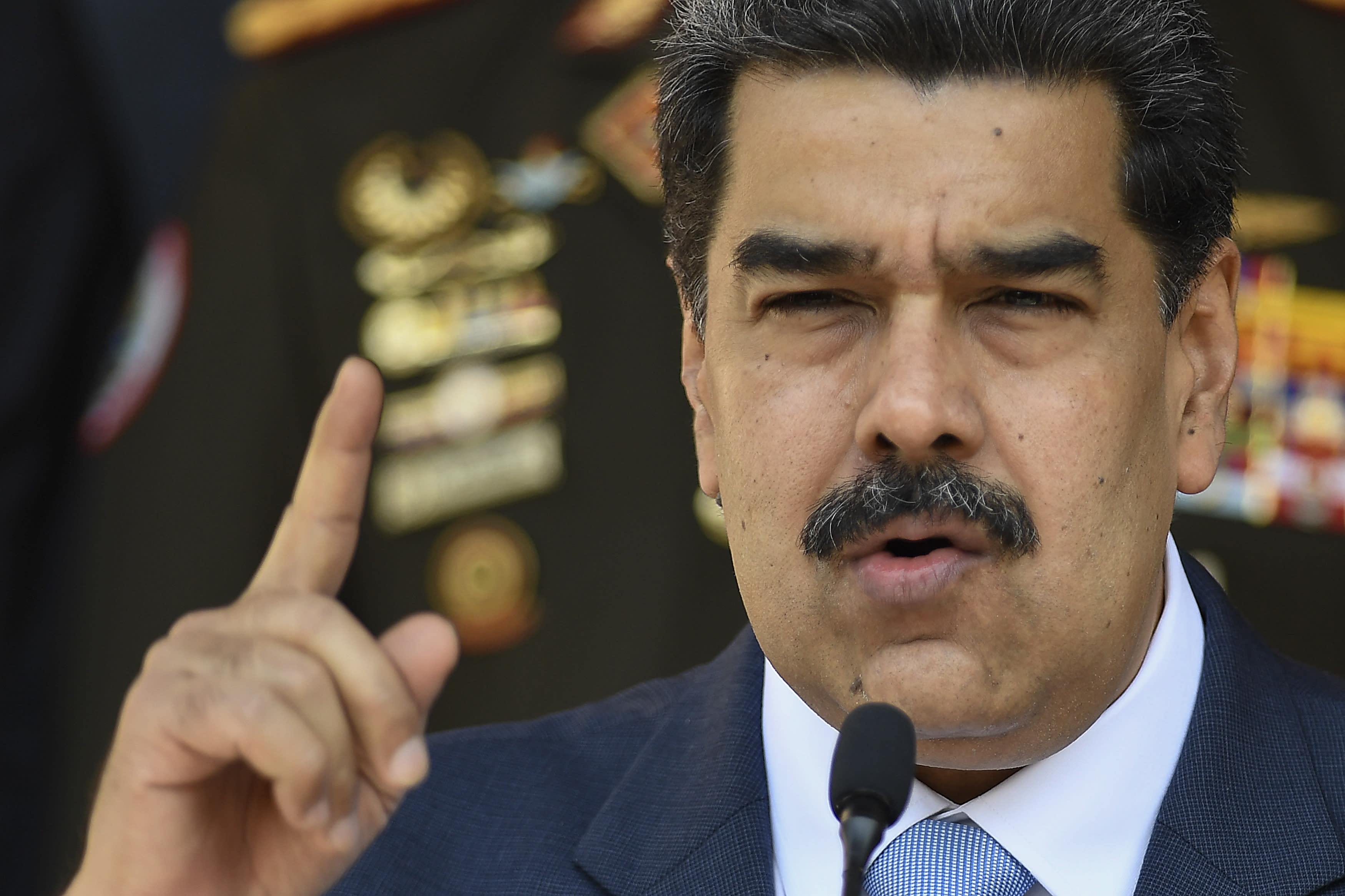 FILE - In this March 12, 2020, file photo, Venezuelan President Nicolas Maduro speaks at a press conference at the Miraflores Presidential Palace in Caracas, Venezuela. The Trump administration will announce Thursday, March 26, 2020, indictments against Maduro and members of his inner circle for effectively converting Venezuela's state into a criminal enterprise at the service of drug traffickers and terrorist groups, according to multiple people familiar with the situation. (AP Photo/Matias Delacroix, File)