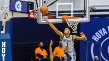 Press Release:  UConn downs GTown