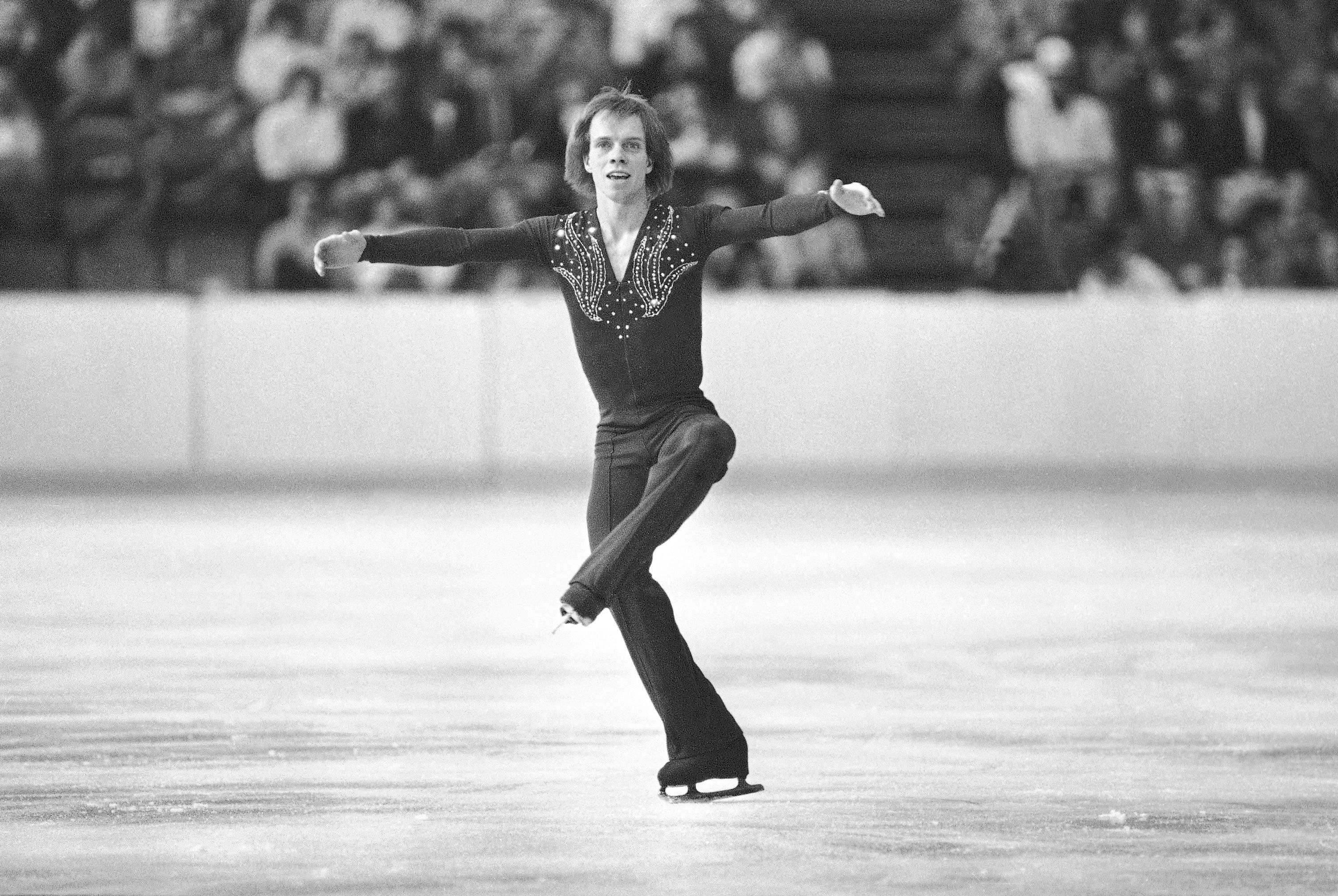FILE - In this Feb. 19, 1980, file photo, Scott Hamilton, of Haverford, Pa., performs during his short program of the Olympic figure skating event in Lake Placid, N.Y. Hamilton gets goosebumps at the mention of Lake Placid. (AP Photo)