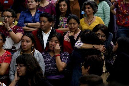 People react after a verdict was given in the Sepur Zarco case in Guatemala City, Guatemala, February 26, 2016. A judge sentenced Guatemalan Army Colonel Esteelmer Reyes Giron to 120 years and ex-military commissioner Heriberto Valdez to 240 years in prison for committing crimes against humanity, as well as sexual violence and slavery against fifteen indigenous women of the Mayan ethnic Q'eqchi group, between 1982 to 1986 at the military base of Sepur Zarco, during Guatemala's bloody 36-year civil war, local media reported. REUTERS/Josue Decavele - RTS87LW