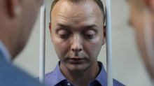 Russian journalists fear growing media persecution after treason arrest