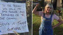 'Gutless thief': Neighbours divided after council intervenes in bizarre garden feud