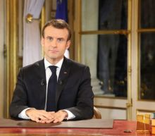 To quell unrest, France's Macron speeds up tax cuts but vows no U-turn