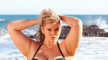 Plus size model Hunter McGrady looks red hot in her new swimwear line
