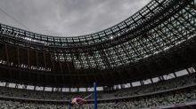 Japan athletes give Tokyo Olympic stadium a test run