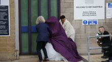Charles Bronson's bride Paula Williamson arrives at jail under purple cloak ahead of wedding