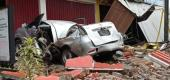 A damaged car and buildings are seen following an earthquake in Mamuju, Indonesia. (Reuters)